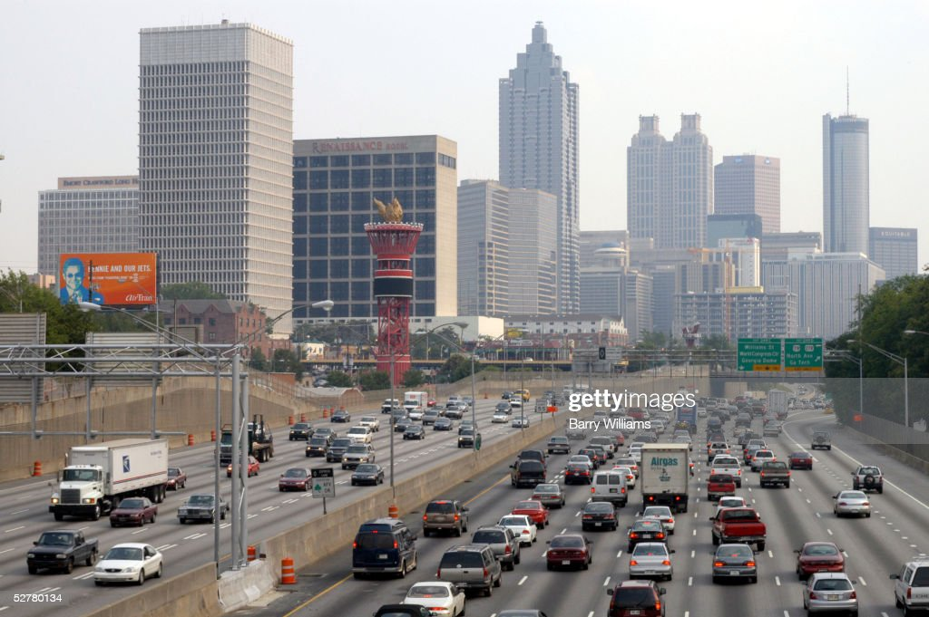 Traffic crawls through downtown Atlanta along Interstate 75/85 during rush hour May 9, 2005 in Atlanta, Georgia. According to a new study Atlanta, like many other cities nationwide, is losing its fight against traffic gridlock. The Texas Transportation Institute ranks Atlanta fourth behind Los Angeles, San Francisco and Washington, D.C., for delays per traveler on its roads. Last year, Atlanta was ranked fifth in the study.