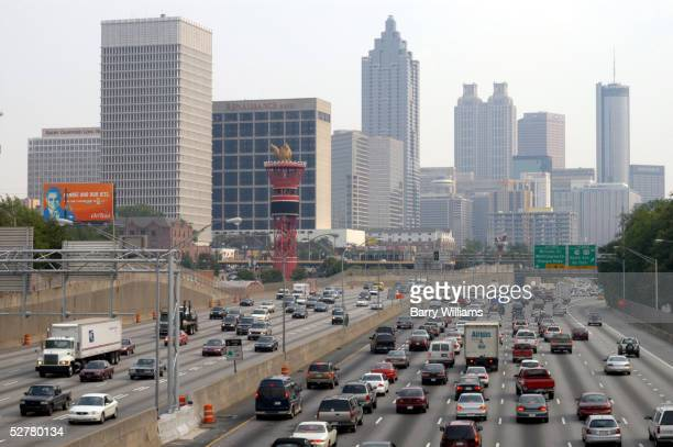 Traffic crawls through downtown Atlanta along Interstate 75/85 during rush hour May 9 2005 in Atlanta Georgia According to a new study Atlanta like...