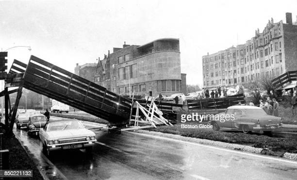 Traffic crawls through the small space left under a collapsed pedestrian bridge over Storrow Drive behind Boston University circa December 1966