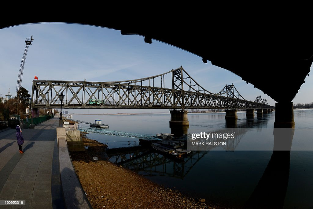 Traffic crosses the Sino-Korean Friendship bridge on the Yalu River which leads to the North Korean town of Sinuiju on February 8, 2013 which is close to the Chinese city of Dandong. US Secretary of State John Kerry warned that North Korea's expected nuclear tests only increase the risk of conflict and would do nothing to help the country's stricken people. The country has vowed to carry out a third nuclear test soon, and concerns have been raised over the type of fissile material used in the device. AFP PHOTO/Mark RALSTON