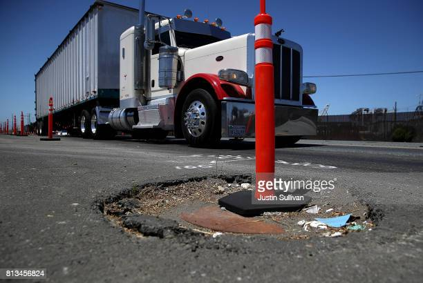 A traffic delineator stands in a pothole on July 12 2017 in Oakland California According to a report by WalletHub roads in San Francisco Oakland and...