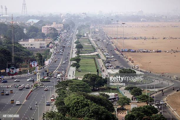 Traffic drives along the Kamarajar Salai road running parallel to Marina Beach and Marina Promenade in Chennai India on Wednesday July 15 2015 A...