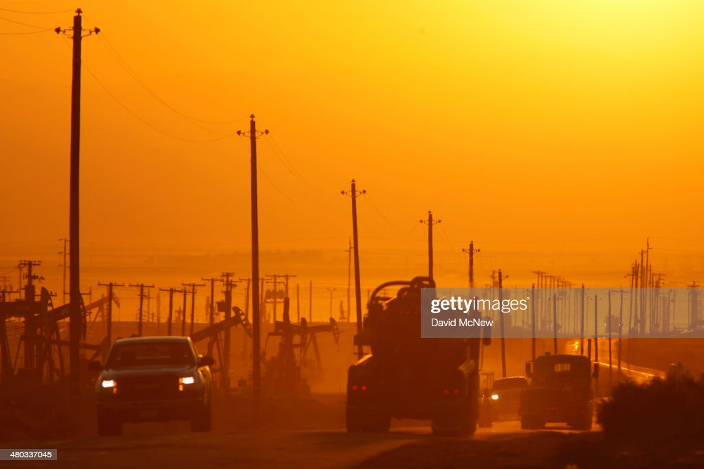 Traffic drives on a street at dawn in an oil field over the Monterey Shale formation where gas and oil extraction using hydraulic fracturing, or fracking, is on the verge of a boom on March 24, 2014 near Lost Hills, California. Critics of fracking in California cite concerns over water usage and possible chemical pollution of ground water sources as California farmers are forced to leave unprecedented expanses of fields fallow in one of the worst droughts in California history. Concerns also include the possibility of earthquakes triggered by the fracking process which injects water, sand and various chemicals under high pressure into the ground to break the rock to release oil and gas for extraction though a well. The 800-mile-long San Andreas Fault runs north and south on the western side of the Monterey Formation in the Central Valley and is thought to be the most dangerous fault in the nation. Proponents of the fracking boom saying that the expansion of petroleum extraction is good for the economy and security by developing more domestic energy sources and increasing gas and oil exports.
