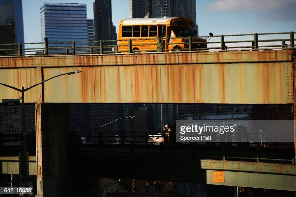 Traffic drives over an old bridge in Brooklyn on February 16 2017 in New York City An annual report by the American Road and Transportation Builders...