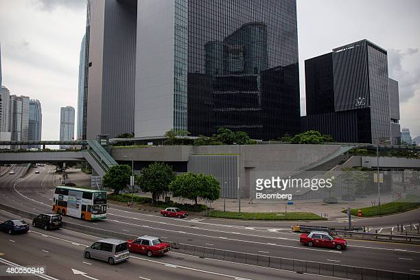 Traffic drives past the Central Government Offices center and the Legislative Council building right in the Admiralty district of Hong Kong China on...