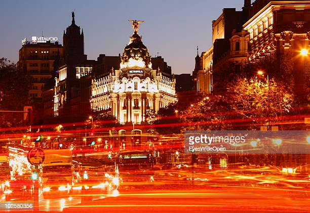 Traffic drives past the Metropolis building at the famous boulevard Gran Via in Madrid at night on May 20 2010 in Madrid Spain Madrid is a big...