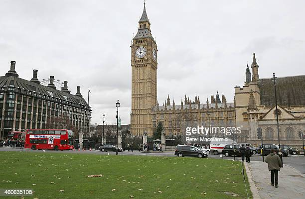 Traffic drives round Parliament Square on December 12 2014 in London England Christmas is an annual religious feast day originally set on December 25...