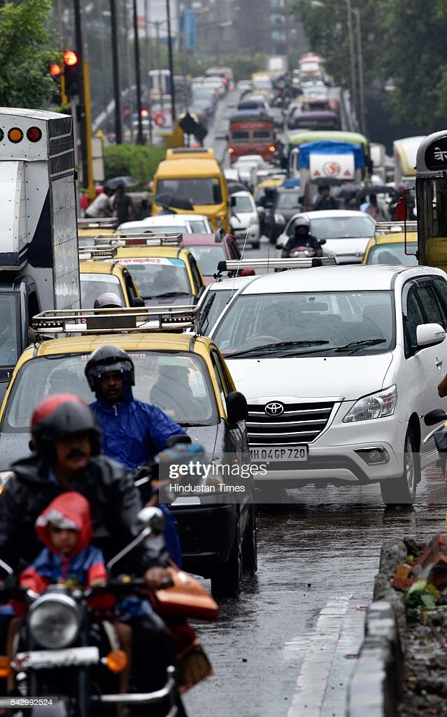 Traffic due to heavy rain at Hindmata, on June 24, 2016 in Mumbai, India. Rains continued to lash Mumbai for the third consecutive day today, slightly disrupting suburban train services, even as the Met department predicted heavy showers. India Meteorological Departments Regional Meteorological Centre in Mumbai predicted intermittent rain with heavy to very heavy rainfall at a few place in the city and its suburbs for the next 24 to 48 hours.