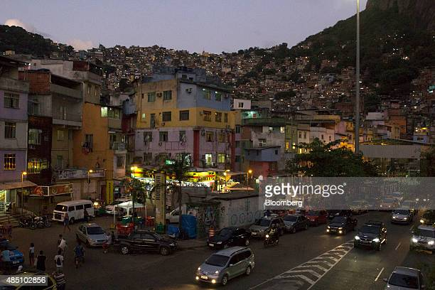 Traffic emerges from the Zuzu Angel Tunnel in front of the Rocinha favela in Rio de Janeiro Brazil on Thursday Aug 20 2015 With joblessness on the...