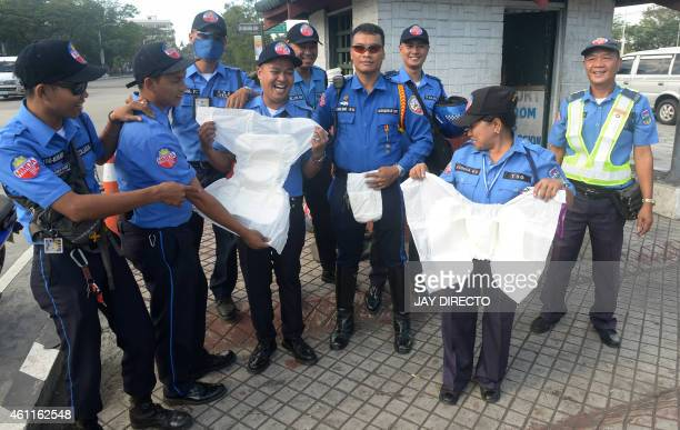 Traffic enforcers of the Metro Manila Development Authority display adult diapers in Manila on January 8 that they were issued to ensure they can...