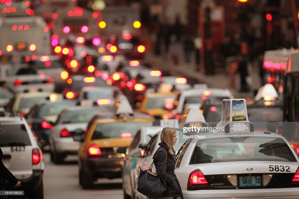 Traffic fills a downtown street as people make their way home from work on October 31 2011 in Chicago Illinois The United Nations Population Fund...
