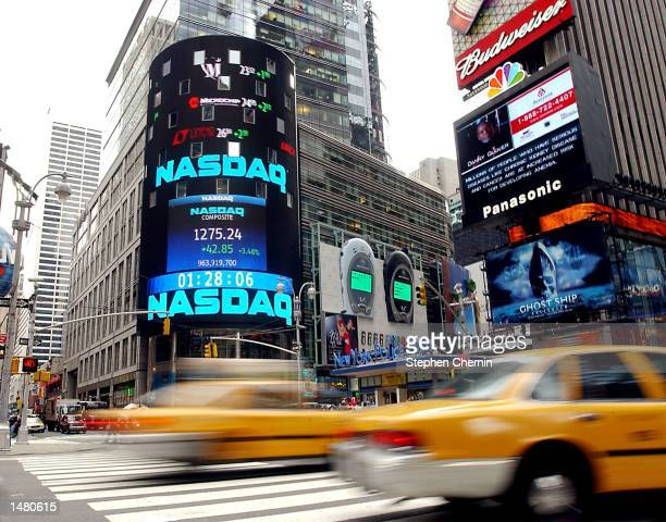 Traffic flows down Broadway past the Nasdaq market site in Times Square October 17 2002 in New York City The Nasdaq 100 closed up 384 percent in...