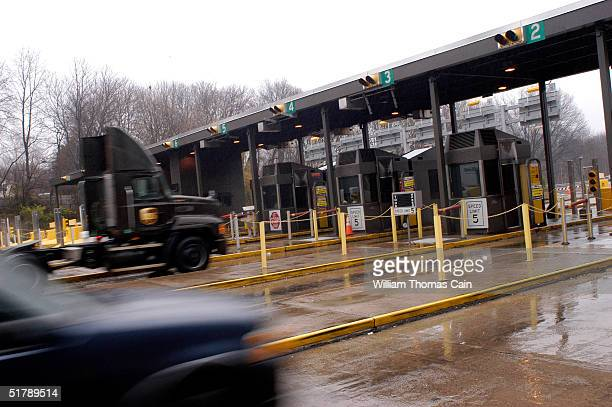 Traffic flows through an entrance to the Pennsylvania Turnpike whose union is on strike November 24 2004 in Willow Grove Pennsylvania The toll...