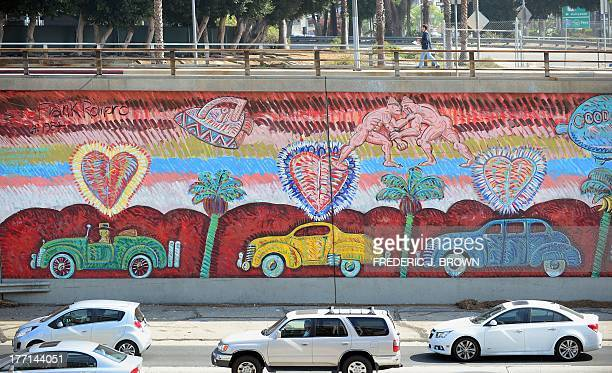 Traffic going north on US 101 flows past Frank Romero's 'Going to the Olympics' mural in Los Angeles on August 15 2013 in California Considered one...