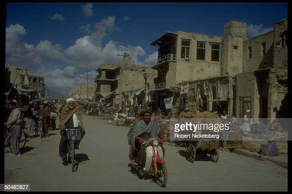 Traffic in bustling market area of war torn city largely des troyed in 10 yrs of govt vs Mujahedeen fighting now enjoying fragile peace