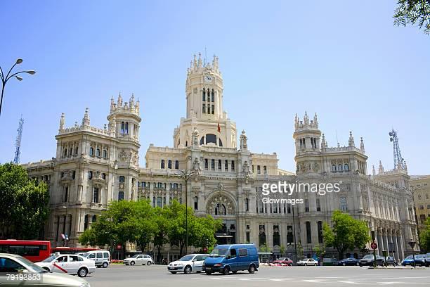 Traffic in front of a government building, Palacio De Comunicaciones, Plaza de Cibeles, Madrid, Spain