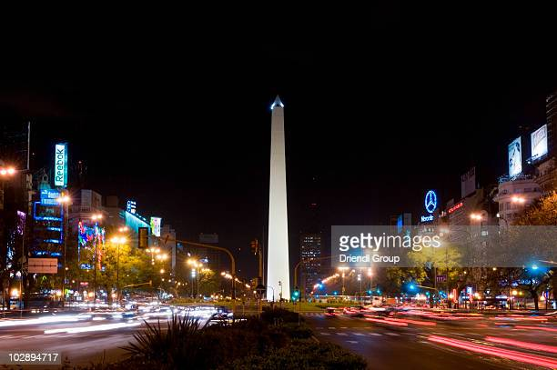 Traffic in motion around the Obelisk at night.