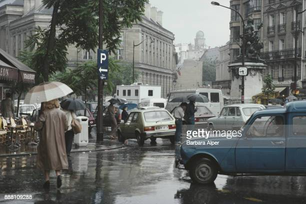 Traffic in Paris on a rainy day France circa 1992