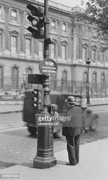 Traffic in Paris pedestrian traffic light with push button near the Louvre Photo Malina