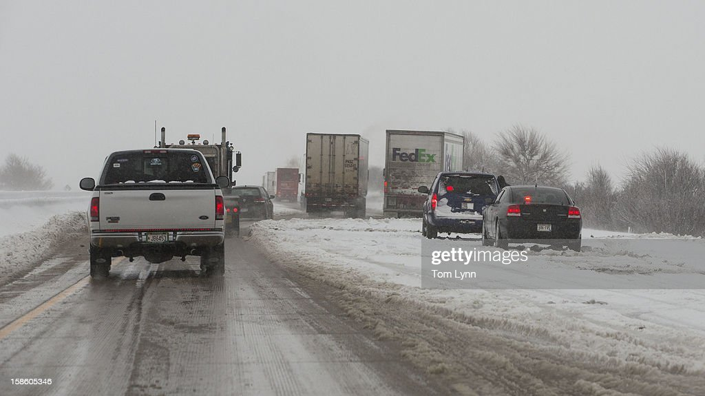 Traffic is backed up along I-90 on December 20, 2012 near Madison, Wisconsin. The State Patrol was warning motorists to stay home as a paralyzing winter storm bore down on Wisconsin In the first significant snowstorm to hit southern Wisconsin in two winters.