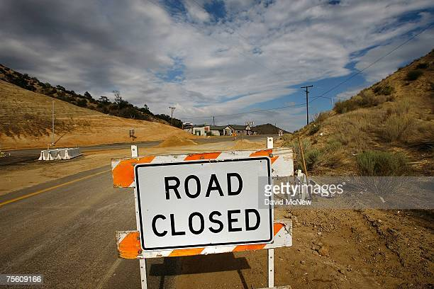 Traffic is detoured away from a business which closed as California Highway 138 got shut down to protect workers from road rage during a roadwidening...