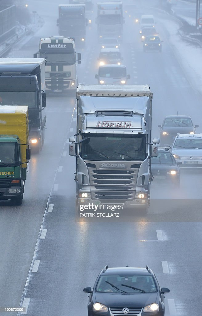 Traffic is pictured on the highway A3 on February 6, 2013 near Duesseldorf, western Germany. Meteorologists forecast unsettled weather for the upcoming days in Germany.