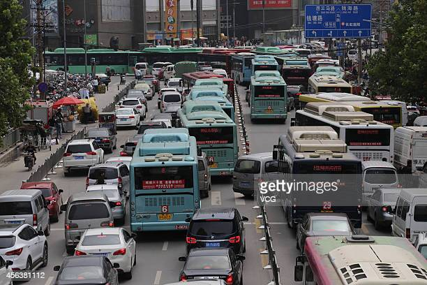 A traffic jam appears during the upcoming National Day of the People's Republic of China on September 30 2014 in Zhengzhou Henan province of China...