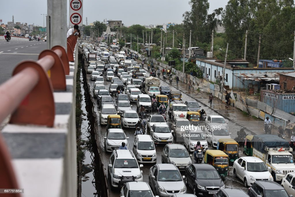 Traffic jam at Hero Honda Chowk, after the heavy rainfall lashed Delhi and NCR on June 19, 2017 in Gurgaon, India. With just one night of rain, several internal roads and at major intersections such as Huda City Centre, Signature Tower Road, Hero Honda Chowk and Iffco Chowk were waterlogged, delaying commuters, especially officegoers.
