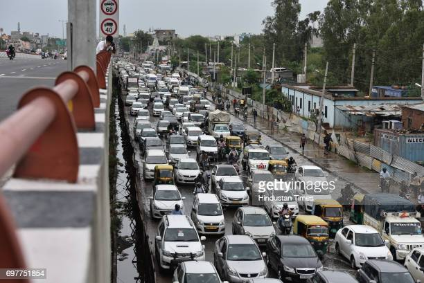 Traffic jam at Hero Honda Chowk after the heavy rainfall lashed Delhi and NCR on June 19 2017 in Gurgaon India With just one night of rain several...