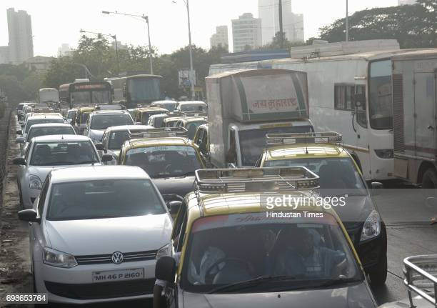 Traffic jam due to the parking of vanity vans as Superstar Rajinikanth shooting for film Kaala Karikaalan at Wadala on May 29 2017 in Mumbai India...