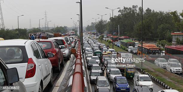 Traffic jam during logged rain water at ring road near Nizamuddin Bridge on August 10 2014 in New Delhi India Heavy rainfall lashed the National...