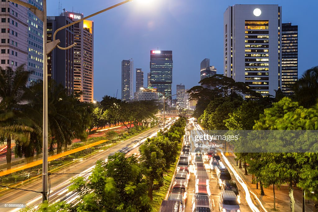 Traffic jam in Jakarta business district at night : Stock Photo