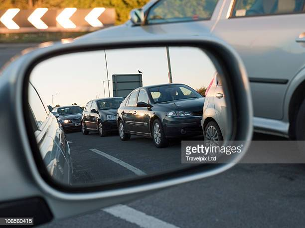 Traffic jam in wing mirror of car