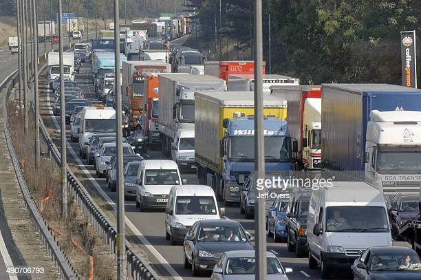 Traffic Jam on M6 Motorway congestion showing various vehicles stuck in slow moving heavy traffic Keywords britain carbon emissions traffic delays...