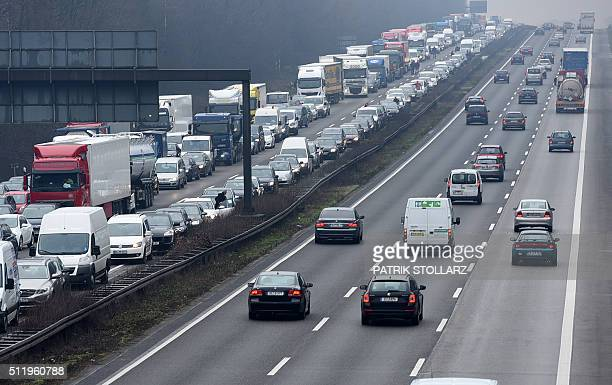 A traffic jam on the A3 motorway near Essen after a car crash caused on Feruary 24 western Germany / AFP / PATRIK STOLLARZ