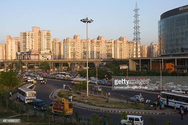 Traffic jam on the road with multistoried residential apartments in the background IFFCO Chowk Gurgaon Haryana