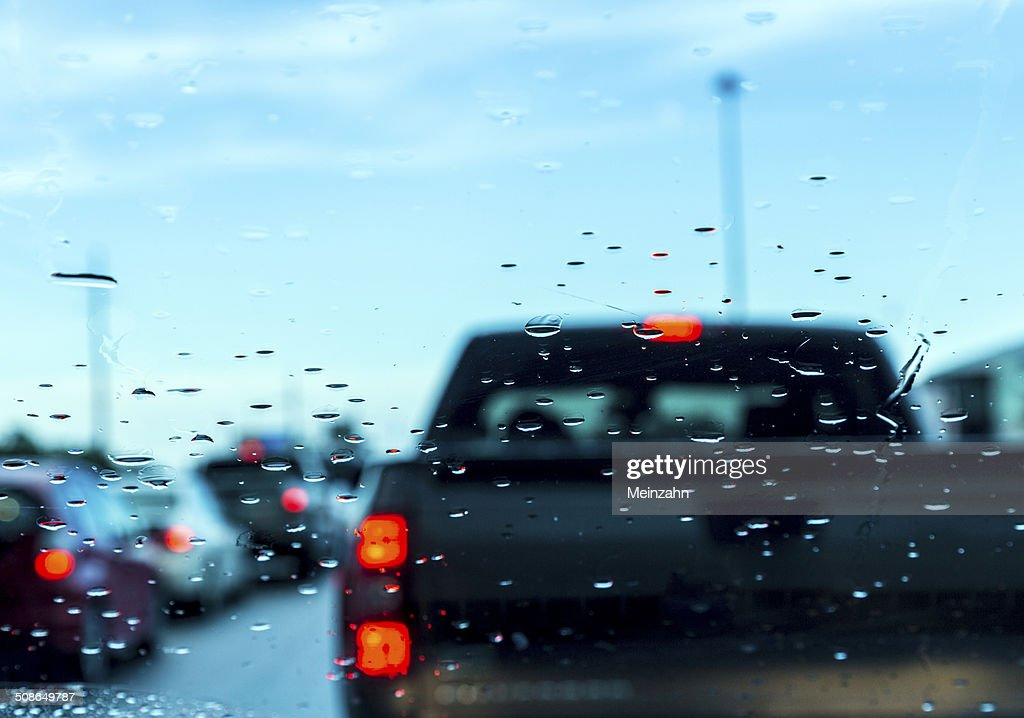 traffic jam seen through car windshield : Stock Photo