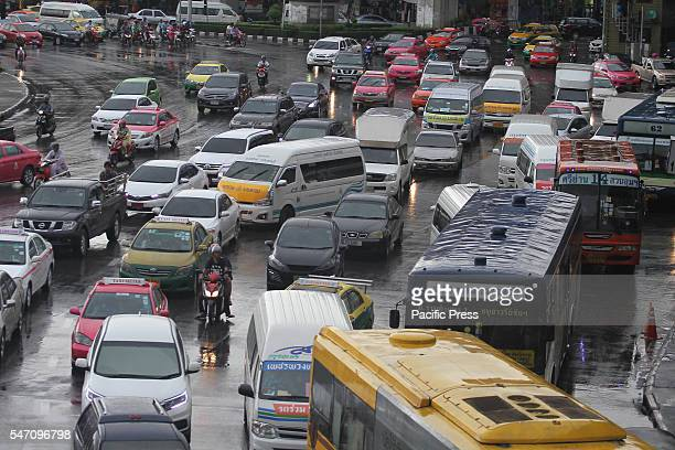 Traffic jam with cars in Bangkok during the rain TomTom navigation system is a leading manufacturer of GPS systems and uses data collected to make...