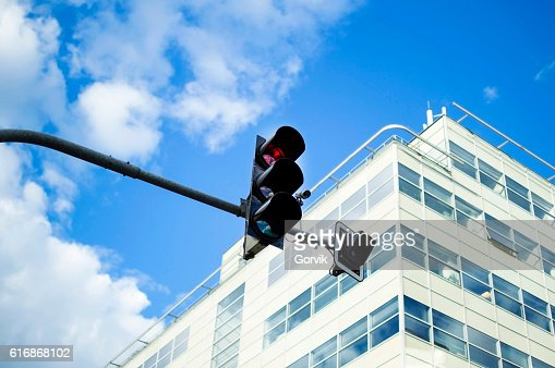 Traffic light activated red light against the sky : Stock Photo
