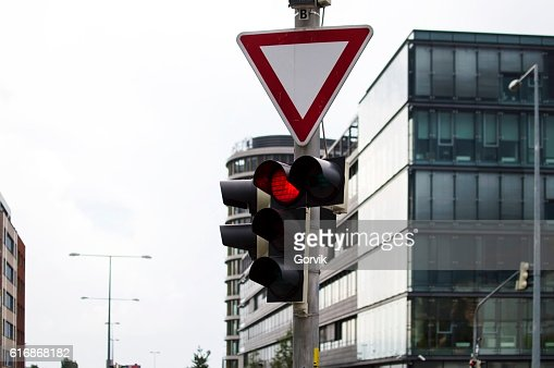 Traffic light activated red light and road sign : Stock Photo