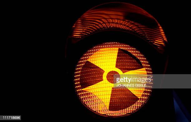 A traffic light decorated with an radioactivity warning sign is pictured on April 4 2011 in Berlin The Fukushima crisis in Japan has triggered a new...