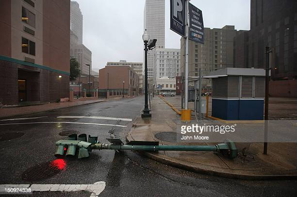 A traffic light glows red after being downed by Hurricane Isaac's winds on August 29 2012 in New Orleans Louisiana The Category 1 hurricane is slowly...
