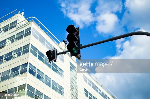 Traffic light green with active against the sky : Stock Photo