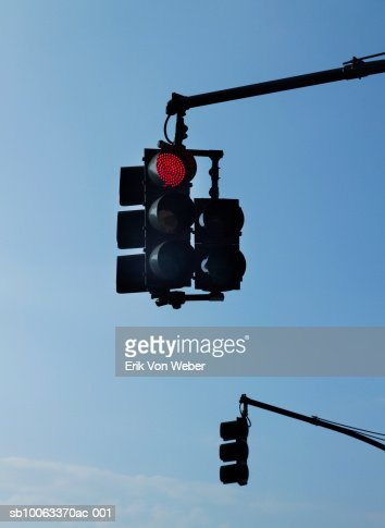 Traffic light on red against clear sky, low angle view : Stock Photo