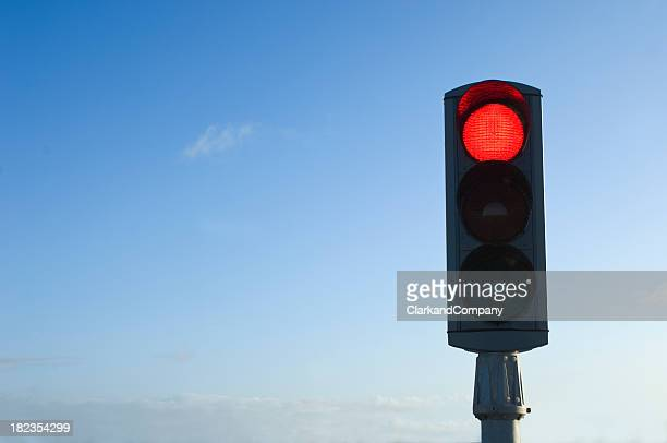 Traffic Light on Red Isolated Against Blue Sky