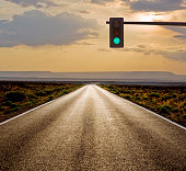 Traffic light on rural road in desert landscape