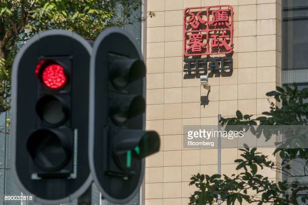 A traffic light stands outside the Hong Kong Independent Commission Against Corruption headquarters in Hong Kong China on Monday Dec 11 2017 Five...