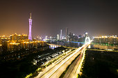 traffic light trails and cityscape at night