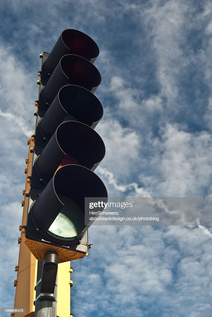 Traffic Lights Infront of Blue Sky : Stock Photo