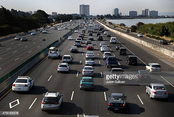 Traffic makes its way along Interstate 80 on July 1 2015 in Berkeley California AAA is projecting that nearly 42 million Americans will travel 50...
